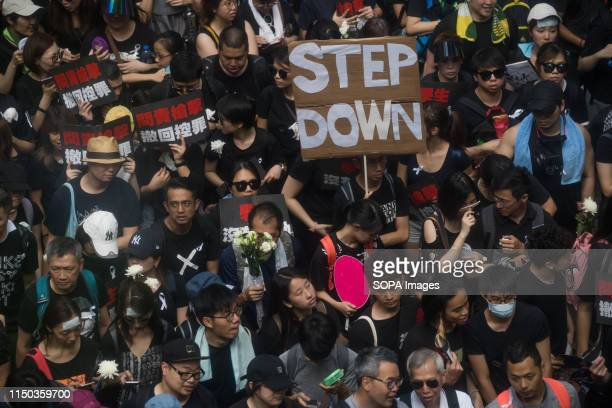 Protesters seen holding placards demanding the Chief Executive Carrie Lam to step down Despite the Chief Executive Carrie Lam's attempt to ease the...