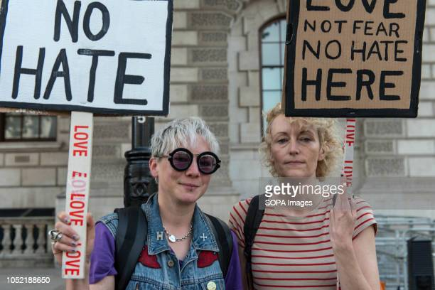 Protesters seen holding placards during the antifascist demonstration against the DFLA in London Counter demonstration organised by United Against...