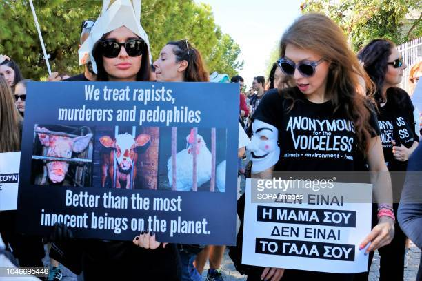 Protesters seen holding placards during the demonstration Hundreds of Greek Animal Rights activists take part in the Annual Animal Rights March in...