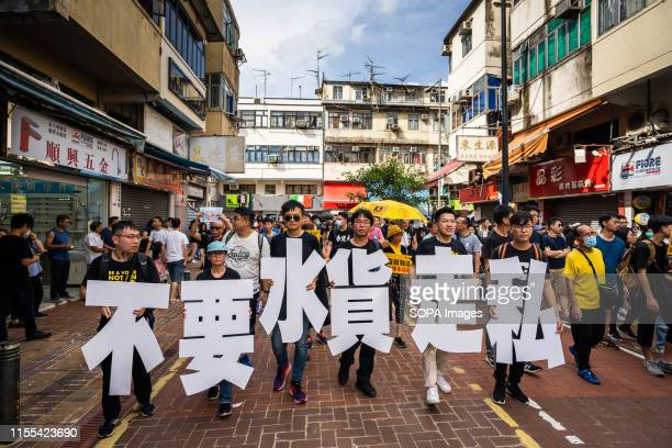 Protesters seen holding placards during the demonstration Thousands of protesters took to the street of the Sheung Shui district in northern Hong...
