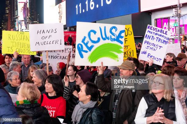 Protesters seen holding placards during the rally Thousands took to Times Square of New York City during a rally to support Robert Mueller's...