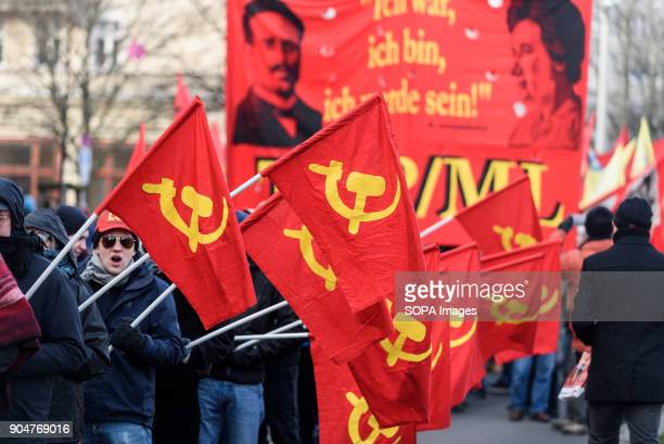 Protesters seen holding several communist flags during the memorial demonstration Several thousand people recalled Rosa Luxemburg and Karl Liebknecht...