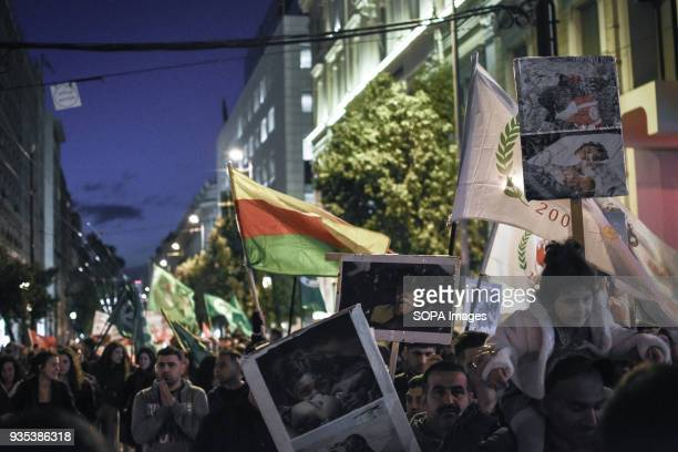 Protesters seen holding several placards and flags during the demonstration Kurds living in Athens marched toward the Turkish embassy the protest...