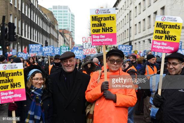 Protesters seen holding several placards during the demonstration Thousand of people marched in London in a protest called NHS in crisis fix it now...