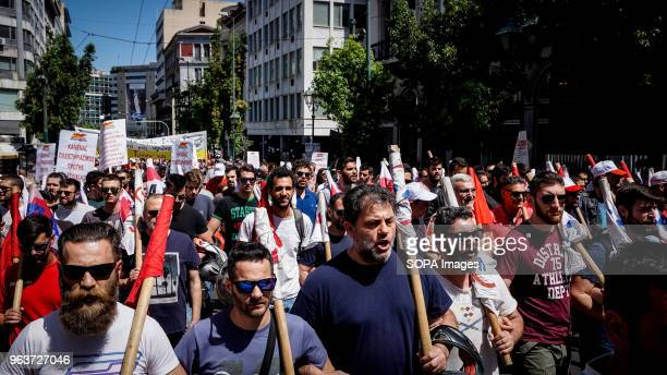 Protesters seen marching down the street during the demonstration A 24hour general strike today called by Greece's labor unions to protest the...