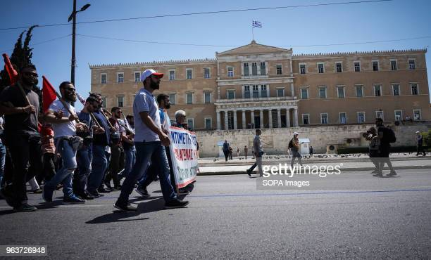 Protesters seen marching in front of the Greek parliament A 24hour general strike today called by Greece's labor unions to protest the government's...