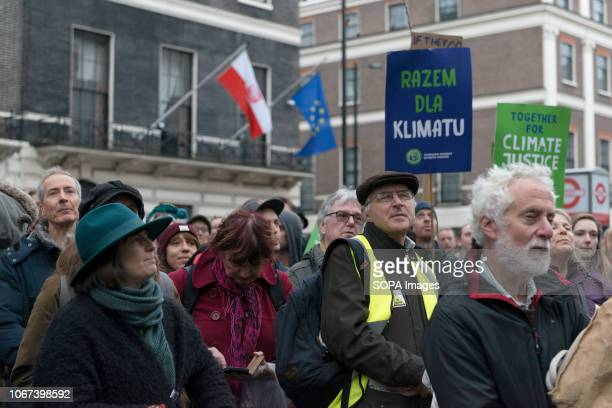 Protesters seen outside the Embassy of the Republic of Poland Hundreds of people rallied in Portland Place near to the Polish embassy and marched to...
