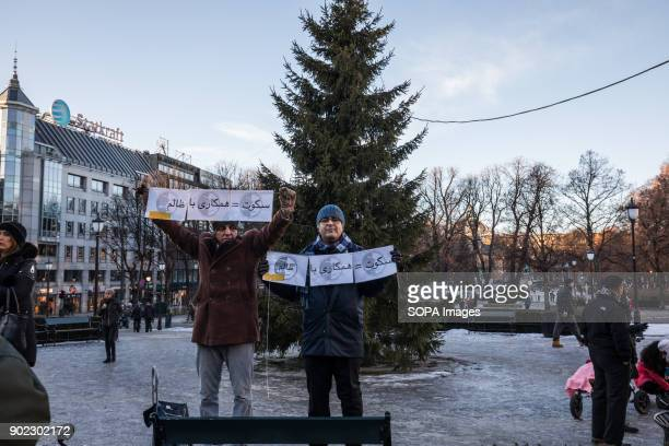 Protesters seen outside the Norwegian parliament holding several placards They are condemning the killings and crackdown of protesters by the Iranian...