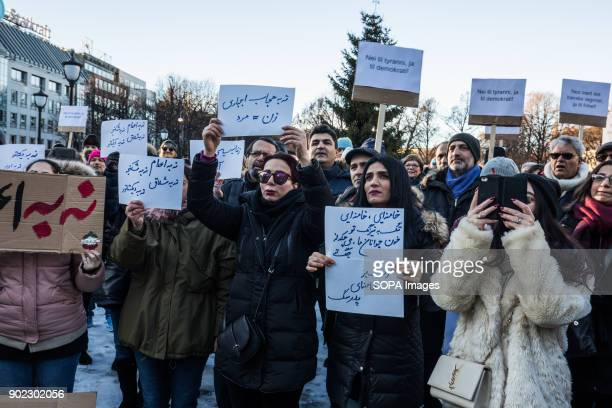 Protesters seen outside the Norwegian parliament while holding several placards They are condemning the killings and crackdown of protesters by the...