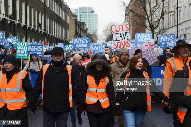 Protesters seen participating while holding placards and posters during the demonstration Thousand of people marched in London in a protest called...