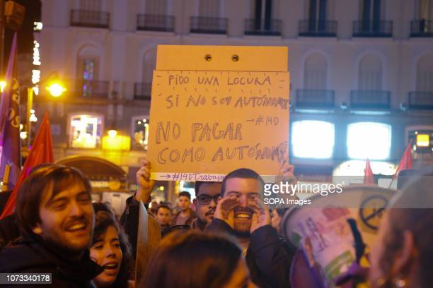 Protesters seen shouting against new forms of labor exploitation during the protest Workers from various active strikes such as Carrefour Inditex...