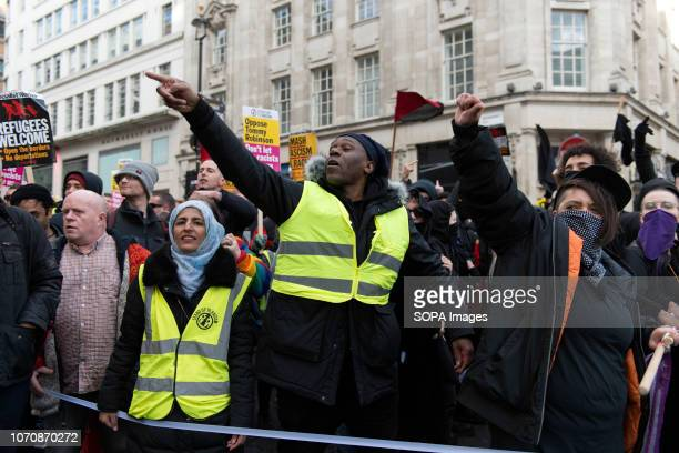 Protesters seen shouting slogans against a few Tommy Robinson supporters that were close to the march during a demonstration against the 'Brexit...