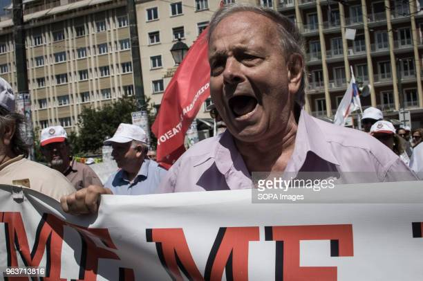 Protesters seen shouting slogans and holding banners as part of a nationwide 24hour strike against reforms linked to a third and final bailout got...