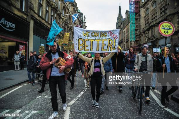 Protesters seen walking along the streets during the demonstration Extinction Rebellion held a lockdown of Edinburgh's North Bridge as part of an...