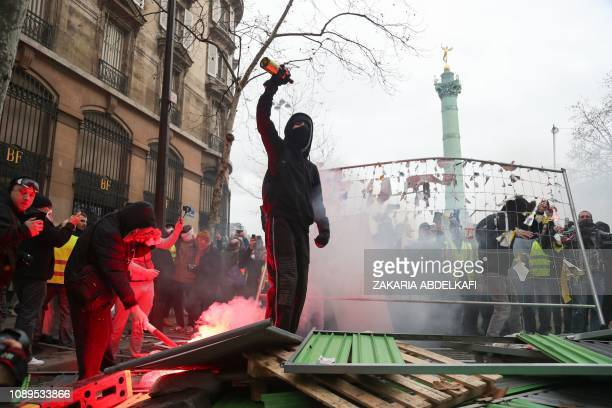 Protesters set a barricade on fire during an antigovernment demonstration called by the Yellow Vests Gilets Jaunes movement in Paris on January 26...