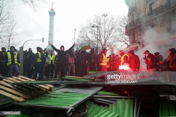 TOPSHOT Protesters set a barricade on fire during an antigovernment demonstration called by the Yellow Vests Gilets Jaunes movement in Paris on...