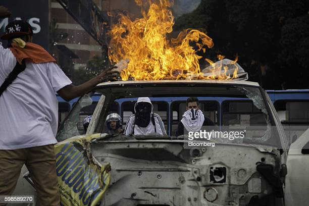 Protesters set a truck on fire on the Francisco Fajardo highway during protests in Caracas Venezuela on Thursday Sept 1 2016 Venezuelans took to the...