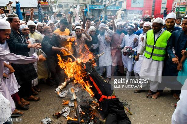 Protesters set an effigy of French President Emmanuel Macron on fire during an anti-France demonstration in Dhaka on November 2, 2020.
