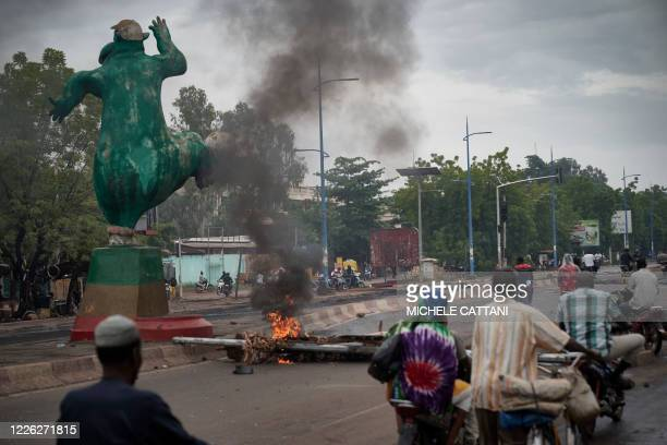 Protesters set barricades to block the circulation on the Martyrs bridge of Bamako on July 11 2020 Malian Prime Minister Boubou Cisse on July 11 2020...