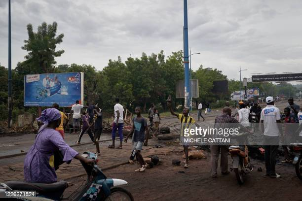 Protesters set barricades to block the circulation on the Martyrs bridge of Bamako on July 11 2020 Violent clashes hapenned in Mali's capital since...