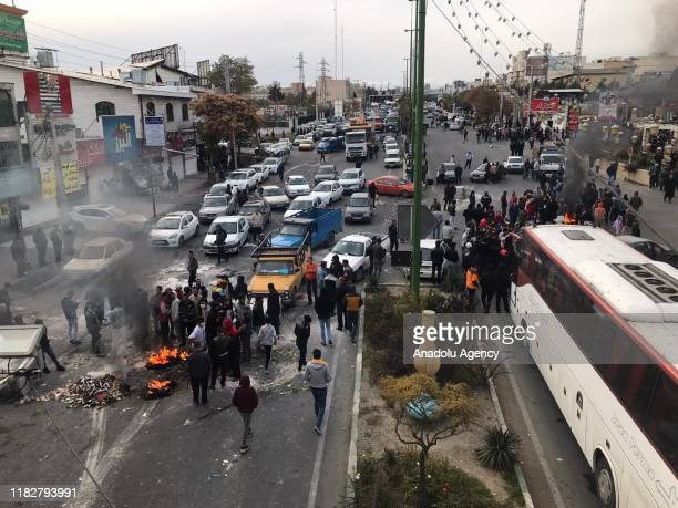 Protesters set fire as they block the roads during a protest against gasoline price hike at Damavand of Tehran Iran on November 16 2019