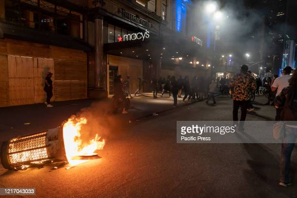 Protesters set fire on garbage receptacle and looters broke into Macys department store Protests turn into looting and destructions in Manhattan...