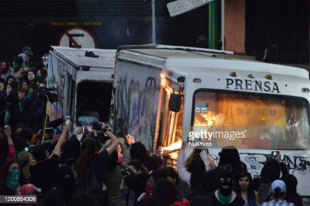 Protesters set fire to a press vehicle as women march in Mexico City on February 14 to protest gender violence Several feminist demonstrators take...