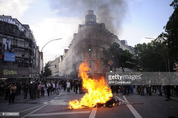 Protesters set fire to block a road on July 7 2017 in Hamburg northern Germany where leaders of the world's top economies gather for a G20 summit...