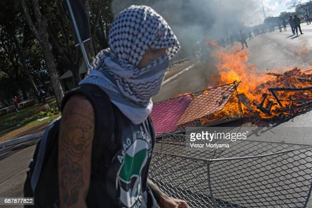 Protesters set fire to furniture outside the Ministery of Agriculture during a clash with police over direct elections in Planalto on May 24 2017 in...