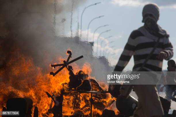 Protesters set fire to furniture outside the Ministry of Agriculture during a clash with the police over direct elections in Planalto on May 24 2017...