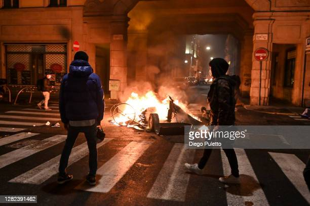 Protesters set fire to public property during an anti government demonstration on October 26 2020 in Turin Italy Following a surge in new COVID19...