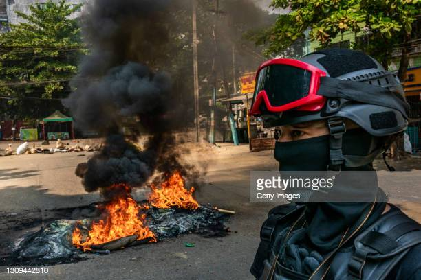 Protesters set fire to tires on a road to slow the progress of security forces on March 27, 2021 in Yangon, Myanmar. Myanmar's military Junta...