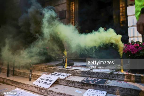 Protesters set smoke flares outside the Hong Kong Economic and Trade Office during the demonstration.. Hongkongers held demonstrations in ten...