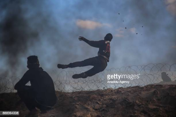 Protesters set tyres on fire as they clash with Israeli security forces during a protest against the US President Donald Trumps recognition of...