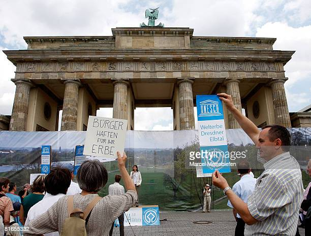 Protesters set up a huge banner showing a picture of the view over the Elbe valley in Dresden eastern Germany where the construction of the...