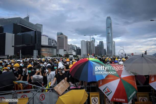 Protesters set up barricades at Lung Wo road outside the Legislative Council in Hong Kong before the flag raising ceremony to mark the 22nd...