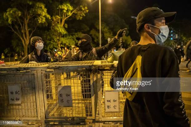 Protesters setup road block during a demonstration in Fanling district on January 26, 2020 in Hong Kong, China. Protesters clash over a proposal of...