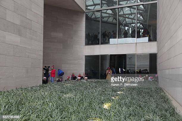 Protesters shelter in the National Gallery of Art's East Building during the Women's March on Washington January 21 2017 in Washington DC The march...