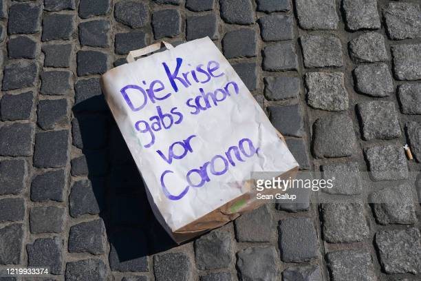 A protester's shopping bag that reads The crisis existed already before corona lies on central market square in a demand for more state support for...