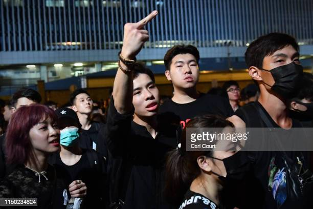 Protesters shout and gesture outside the Legislative Council building as they demonstrate against the nowsuspended extradition bill on June 16 2019...