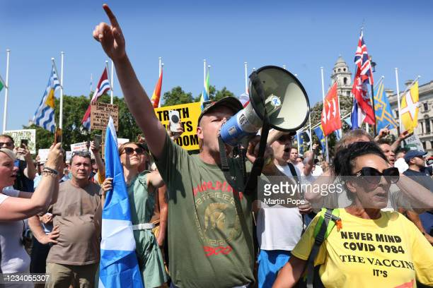 Protesters shout anti government slogans at the Houses of Parliament from Parliament Square as part of a freedom protest on July 19, 2021 in London,...