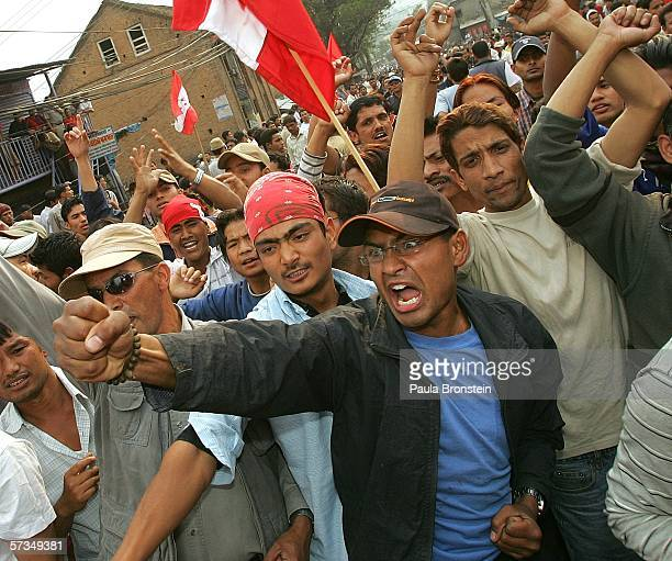 Protesters shout anti-government slogans during a demonstration that turned violent protesting the rule of King Gyanendra April 17, 2006 in...