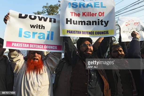 Protesters shout antiUS and Israeli slogans during a protest in Lahore on December 7 following US President Donald Trump's decision to officially...