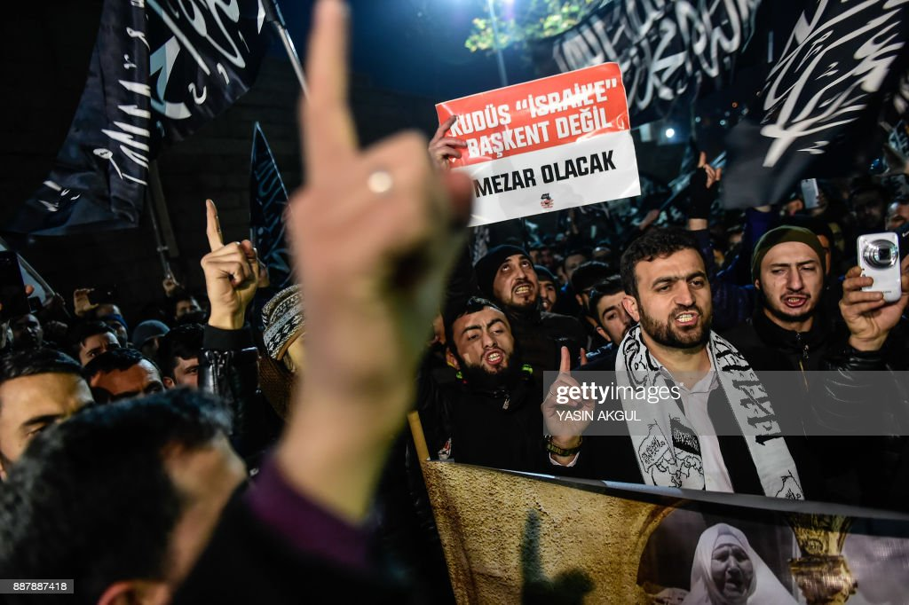 Protesters shout anti-USA and anti-Israel slogans as they a hold placard reading 'Jerusalem will not be a capital to Israel, It will be a grave' during a demonstration after the US president recognised Jerusalem as Israel's capital in Istanbul on December 7, 2017. US President Donald Trump's recognition of Jerusalem as Israel's capital sparked Palestinian protests, sporadic clashes and a call for a new intifada on December 7 as fears grew of fresh bloodshed in the region. Trump's announcement also prompted an almost universal diplomatic backlash, with fresh warnings from Turkey, the European Union and Russia. /