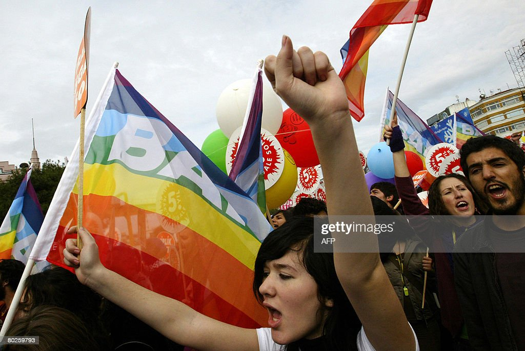 Protesters shout anti-war slogans as they hold flags reading
