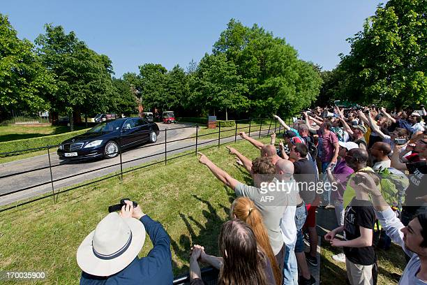 Protesters shout as a vehicle arrives at the drive to the venue where it is thought the 61st annual Bilderberg Meetings is taking place in Watford,...