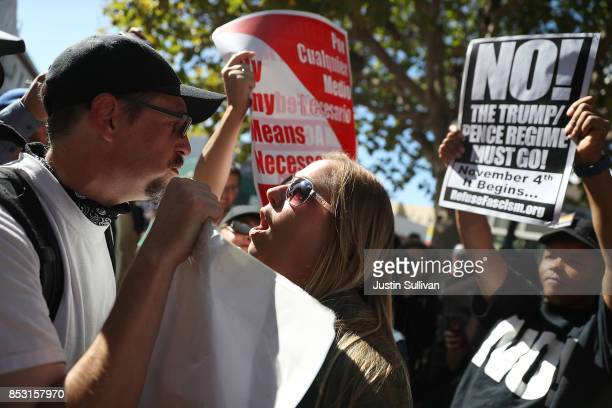 Protesters shout at each other during a free speech rally with right wing commentator Milo Yiannopoulos at UC Berkeley on September 24 2017 in...