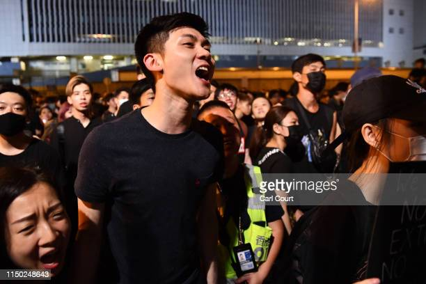 Protesters shout near the Legislative Council building as they demonstrate against the nowsuspended extradition bill on June 16 2019 in Hong Kong...