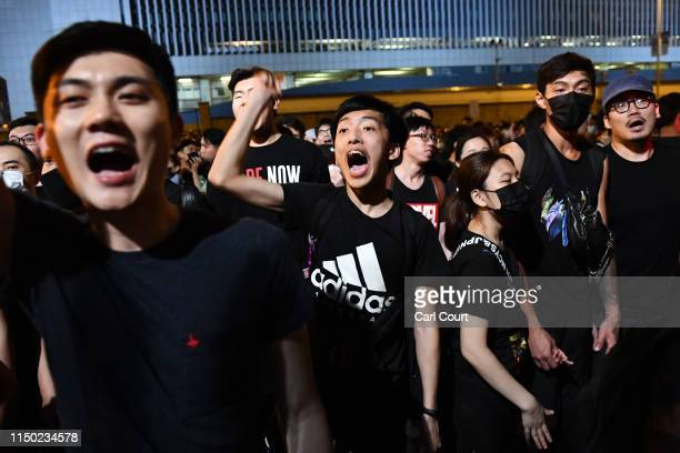 Protesters shout outside the Legislative Council building as they demonstrate against the nowsuspended extradition bill on June 16 2019 in Hong Kong...