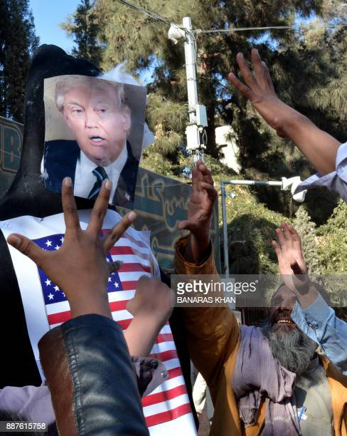 Protesters shout slogan next to an effigy depecting US President Donald Trump during an antiUS and Israeli protest in Quetta on December 7 2017...